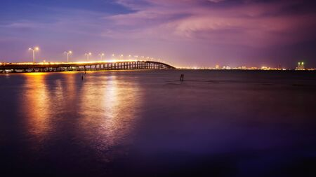 south padre: The Queen Isabella Causeway (bridge) leads to South Padre Island, Texas at sunset Stock Photo