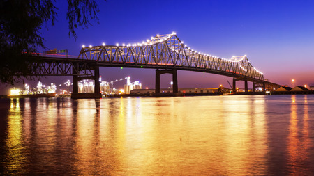 Horace Wilkinson Bridge crosses over the Mississippi River at night in Baton Rouge, Louisiana
