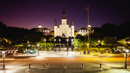 St Louis Cathedral and Jackson Square in New Orleans French Quarter as night falls in Louisiana