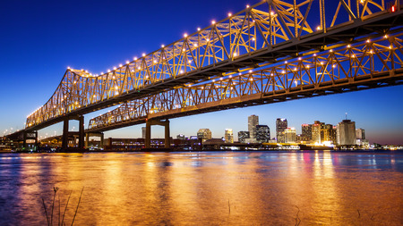 Crescent City Connection Bridge carries traffic over the Mississippi River into New Orleans at night 写真素材
