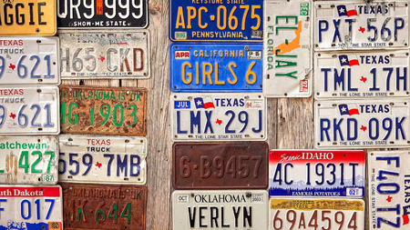 Old license plates are displayed on a wooden barn in Luckenbach, Texas