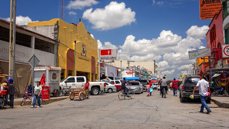 tx: Busy intersection and street in the Mexican border town of Nuevo Progreso, Mexico
