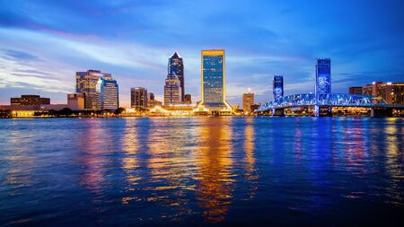 Jacksonville, Florida city skyline over the St. Johns River (building logos blurred for commercial use)