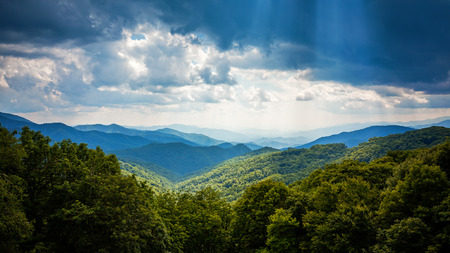 Sunbeams and storm clouds in the Appalachian Mountains along Blue Ridge Parkway in Asheville, North Carolina