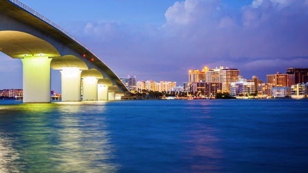 City of Sarasota, Florida across elevated bridge and bay at night