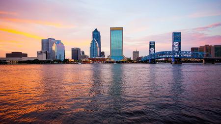 Jacksonville, Florida city skyline over the St. John's River (building logos blurred for commercial use)