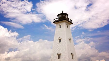 Dreamy lighthouse against cloud filled sky in Gulfport, Mississippi Stock Photo