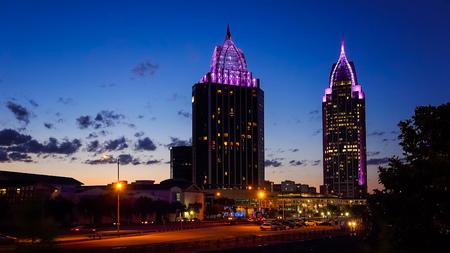 Downtown Mobile, Alabama skyline as night falls