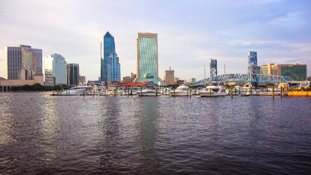 Jacksonville, Florida city skyline over the St. Johns River (logos blurred for commercial use)