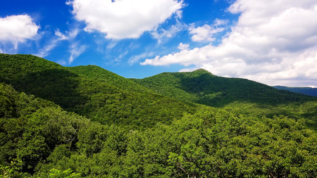 Clouds roll past the scenic green mountains of Blue Ridge Parkway in Asheville, North Carolina