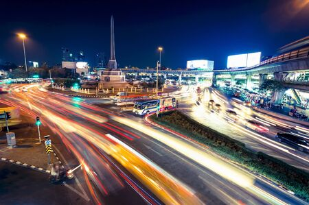 Traffic in roundabout surrounding Victory Monument at night in Bangkok, Thailand