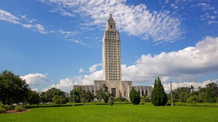 Louisiana State Capitol Building against sky in Baton Rouge Фото со стока
