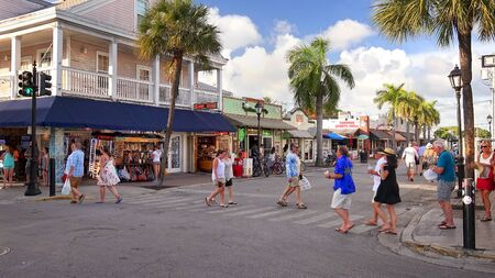KEY WEST, FLORIDA - JUNE 4th: Tourists explore shops along Duval Street in downtown Key West, Florida on June 4th, 2016. Editoriali