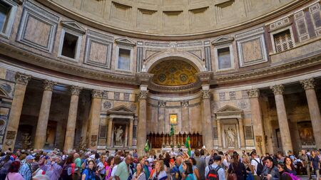 Crowd of tourists inside the Pantheon, the finest remaining example of Ancient Roman architecture, in Rome, Italy