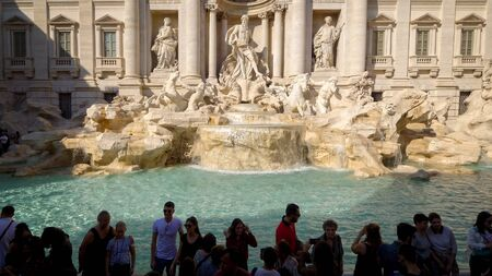 Trevi Fountain in Rome is one of Italys most famous landmarks and often surrounded by tourists Editoriali