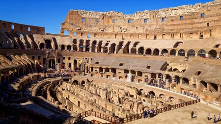 Roman Colosseum interior shows architectural details in Rome, Italy