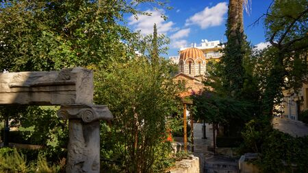 Byzantine orthodox church dome and garden in Plaka, Athens, Greece