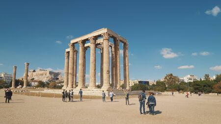 Tourists view the ruins of the Temple of Olympian Zeus in Athens, Greece Editoriali