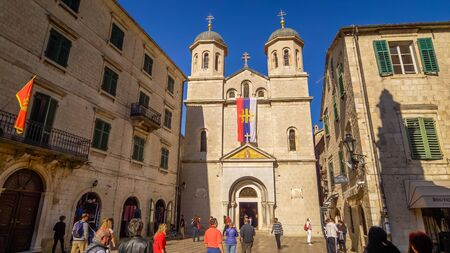 Tourists in the square in front of the Orthodox Church of St Nicholas in Kotor, Montenegro Editoriali