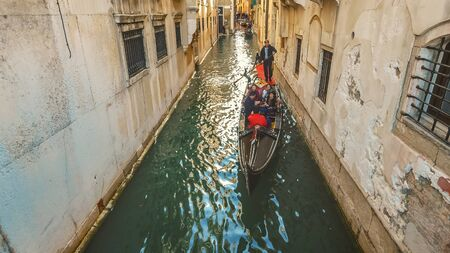 Tourist gondola in narrow side canal in Venice, Italy Editoriali