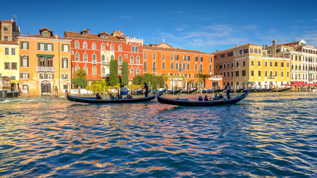 Gondolas in silhouette on the Grand Canal in Venice, Italy, faces blurred for commercial use Banco de Imagens