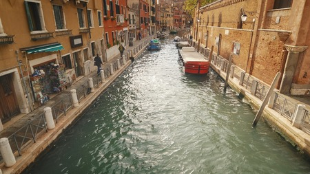 Quite picturesque side canal off of the Grand Canal in Venice, Italy, faces blurred for commercial use Archivio Fotografico