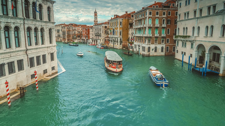 Boats traverse the Grand Canal along amazing city architecture in Venice, Italy Archivio Fotografico