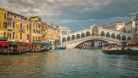 Famous landmark the Rialto Bridge crosses over the Grand Canal in Venice, Italy