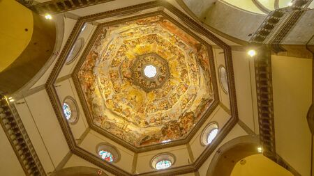 Ornately painted dome of Florence Cathedral in Florence, Italy, interior