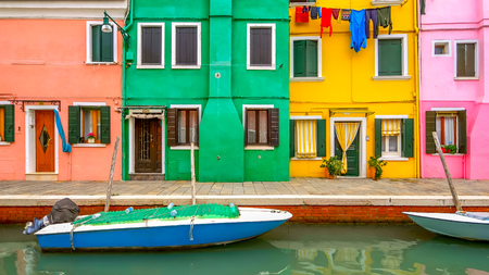 Laundry hanging to dry from clothesline in colorful neighborhood on Burano Island, Venice, Italy