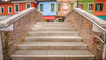 Steps of bridge over canal in the fishing village of Burano in Venice, Italy