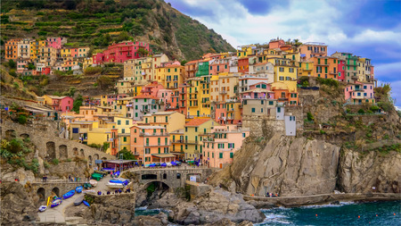 The seaside village of Manarola sits on the famous cliffs of Cinque Terre in La Spezia, Italy