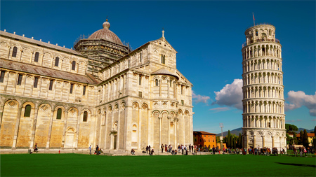 Tourists at Cathedral and Leaning Tower of Pisa in Italy