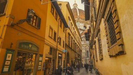 FLORENCE, ITALY - NOVEMBER 12th: View of Florence Cathedral while looking down a narrow street in Florence, Italy on November 12th, 2017 Editoriali