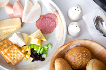 Breakfast with various of breads, cheese, ham, crakers, salami and pickles. In room dining service. 5-Star Hotel room service.