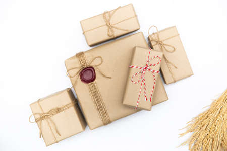 Gift box in vintage brown color on isolated white background. Empty space for text ot product presentation.