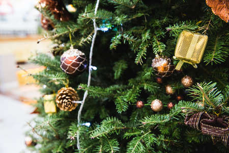 Decorated Christmas tree with toys, gift box, little pine, lights and bauble. Chritmas and Happy New year concept. Can be used for backround.