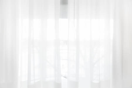 Blurred curtain window and stationery box with sunlight. For montage product display or design key visual layout.