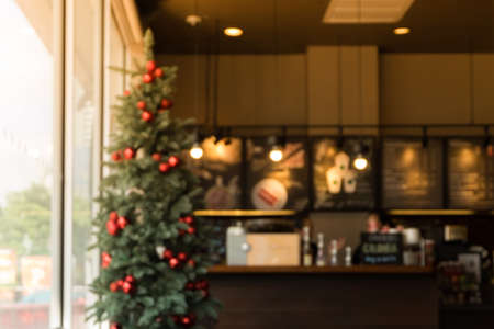 Blurred chistmas holiday background with  coffee shop (cafe) and restaurant shop interior background in winter season -  for your product display or montage. vintage effect tone 스톡 콘텐츠