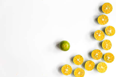 Top view, flat lay of fresh mandarin oranges on white background with copy space. Fruit composition