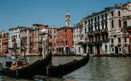 Gondola on canal in Venice. The charm of Italy.