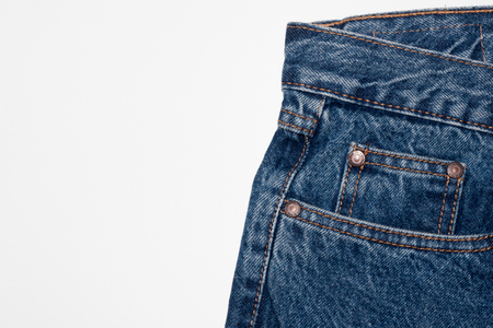 Classic blue jeans front pockets. rough denim texture. jeans on a pure white background. free space for your text