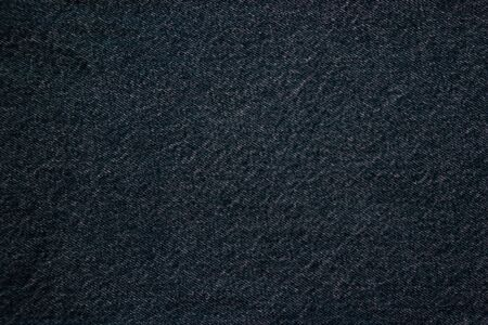 jeans fabric denim texture background. closeup. high quality denim. rough cotton jeans fabric. denim material. denim fabric for casual  clothes, natural material for working clothes Фото со стока