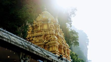 Golden roof dome hindu temple in batu caves