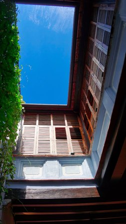 Interior courtyard open space of shophouses in Penang