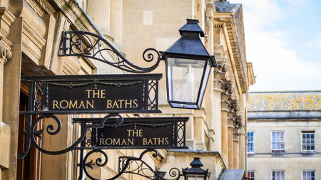 View of Roman Baths Sign in Bath England Imagens