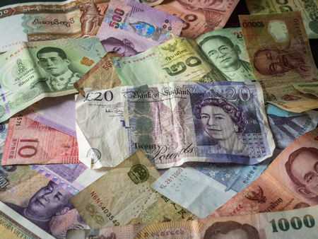 Close up of foreign banknotes with british money Stock Photo