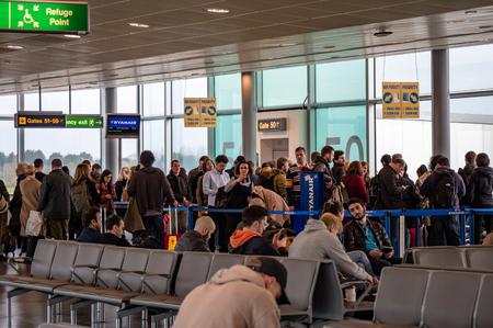 Passengers queuing for Ryanair flight