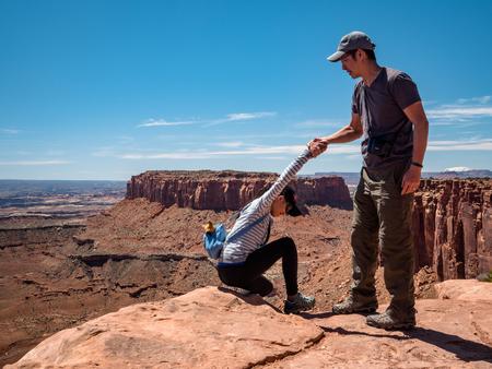 Asian tourists posing for photos at the Canyonlands Utah
