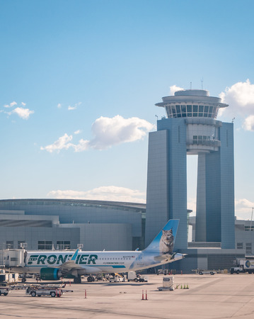 Frontier Air jet plane parked at Las Vegas McCarran Airport Редакционное
